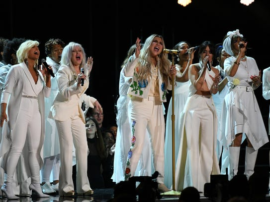"Kesha, center, performs ""Praying"" with Cyndi Lauper,"