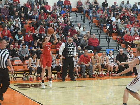 Bellevue's Gabby Turner fires a 3-pointer in front of Norton's bench Tuesday. The Lady Red made 10 3s.