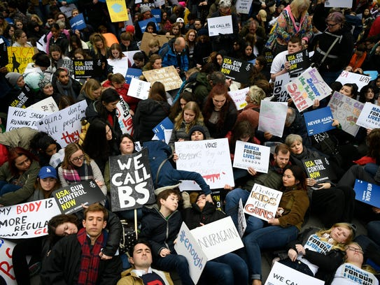 """Supporters of stricter gun control stage a """"die in"""""""