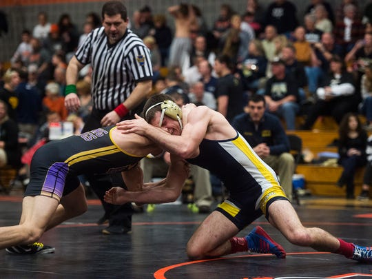 Eastern York's Conner Barshinger grapples with Boiling Springs' Travis Wickard in the 160-pound semifinal bout Saturday during Section I AA wrestling at Susquenita High School.