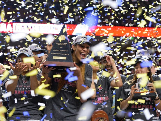 Confetti falls on South Carolina forward A'ja Wilson (22) and the rest of the Lady Gamecocks after they were presented with the SEC women's basketball tournament championship trophy after they defeated Mississippi State 59-49 on Sunday, March 5, 2017 at Bon Secours Wellness Arena.