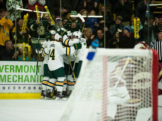 Vermont celebrates a goal during the men's hockey game between the Boston College Eagles and the Vermont Catamounts at Gutterson Field House on Friday night November 10, 2017 in Burlington.