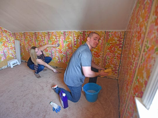 Laura and Dennis Hill getting ready to remove wallpaper