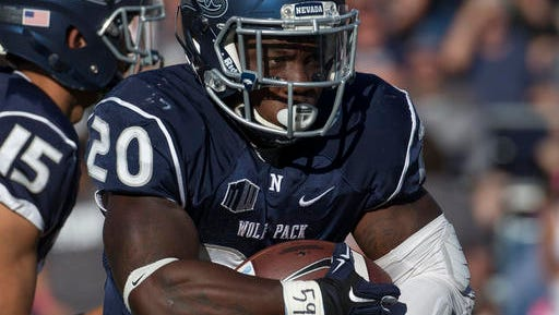 Nevada's James Butler looks to run against Fresno State in the first quarter Saturday.