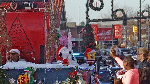 Santa Claus waves at children at the 2015 Anderson Christmas Parade. This year's Christmas parade will start at 3 p.m. Sunday in downtown Anderson.
