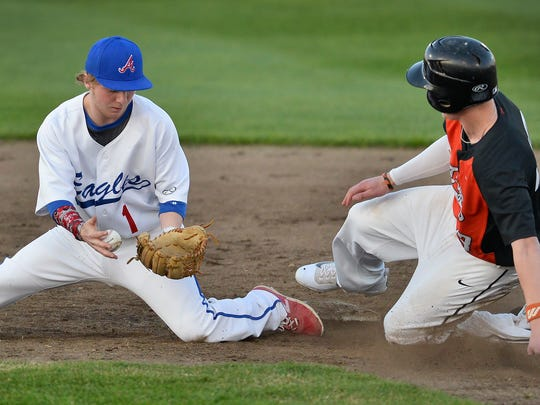 St. Cloud Apollo's Adam Schleicher (1) bobbles the ball after the throw to second took an odd bounce and allowed St. Cloud Tech's Drew Amundson (13) to get the stolen base in the third inning Friday night, April 22 at Dick Putz Field.