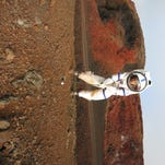 Jocelyn Dunn, a doctoral student at Purdue University, poses in a dome where she spent eight months simulating a colony on Mars. The NASA mission, called HI-SEAS, took place on a volcano in Hawaii was meant to simulate a Martian environment.