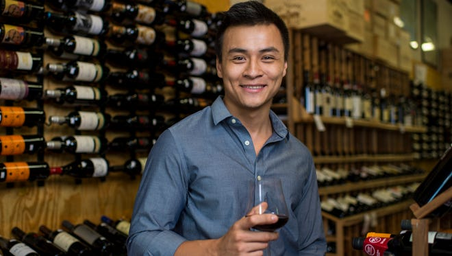 David Huynh poses at Philippe's Wine Cellars  in Lafayette.