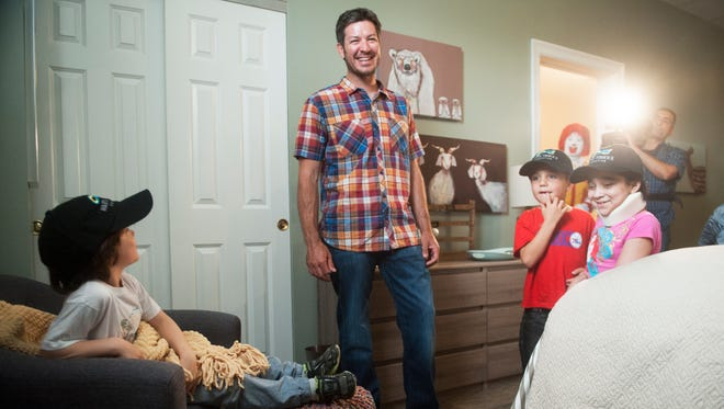 NASCAR driver Martin Truex Jr, a Manahawkin native, tours the Ronald McDonald House of Southern New Jersey's newest bedroom that was built and decorated thanks to a generous donation by the Martin Truex Jr. Foundation, an organization started by Truex Jr. and his longtime partner Sherry Pollex in 2007 with a focus on raising awareness and funding for childhood and ovarian cancer initiatives.