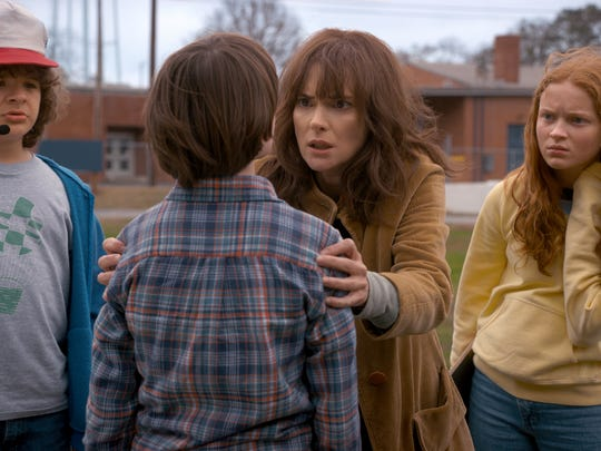"Winona Ryder (second from right) in a scene from the news season of Netflix's ""Stranger Things""."