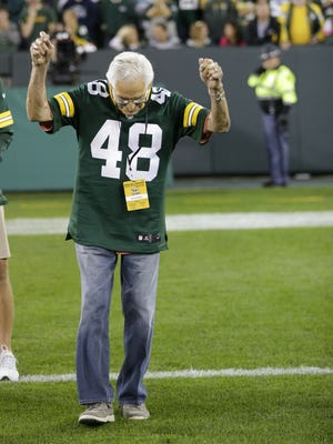 Former Green Bay Packers halfback Al Carmichael (1953-58) is introduced at halftime during alumni night events at the game against the Seattle Seahawks at Lambeau FIeld on Sunday, Sept. 20, 2015.