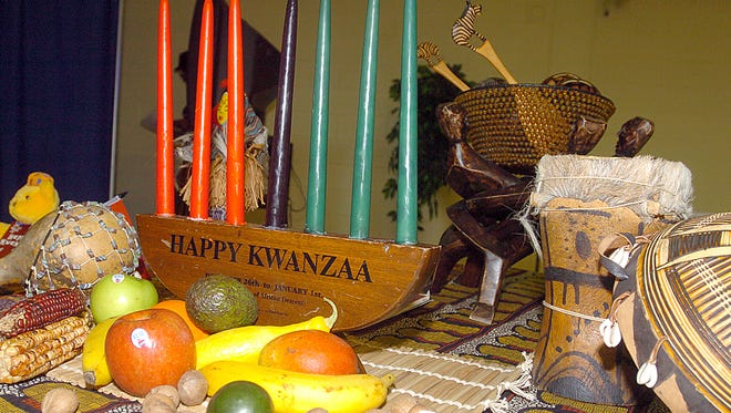 Symbols of Kwanzaa lay on a table at the T.R. White Sportsplex during a previous Kwanzaa celebration in this file photo.