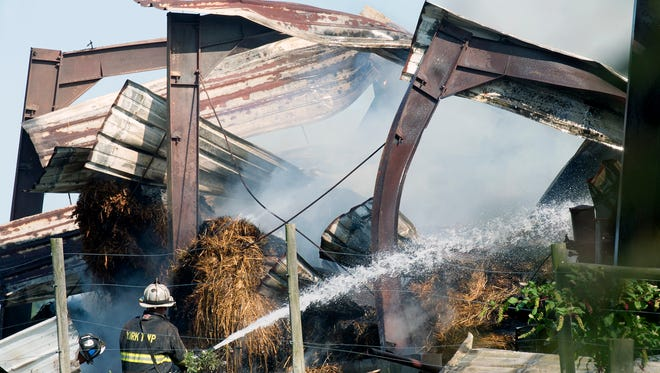 Firefighters respond to a fight a barn fire in York Township on Sunday on Oak Road, near McDowell Drive and Coventry Road.