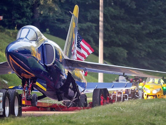 Millington's Blue Angel which has greeted visitors to the Navy Base since 1975, returns to it's home at the Millington airport via Covington Pioke after the completion of a paint and restoration project at a Memphis auto body shop.
