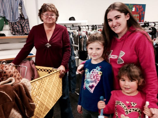 On Black Friday, items were 25 percent off at the Salvation Army Superstore at 1737 S. Campbell Ave. Alfreda Barlett, left, shops with her daughter Nichole Dahl and her two granddaughters: Marlee, 7, and MIla, 4.