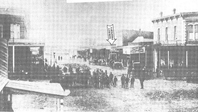 A photo from around 1900, shows 614 Seventh with the arrow pointing at it. The structure, built in 1882, is one of the oldest brick buildings in Wichita Falls.