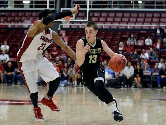 Vanderbilt's Riley LaChance (13) dribbles against Stanford's Anthony Brown (21) during the first half of an NCAA college basketball game in the National Invitation Tournament in Stanford, Calif., Tuesday, March 24, 2015.