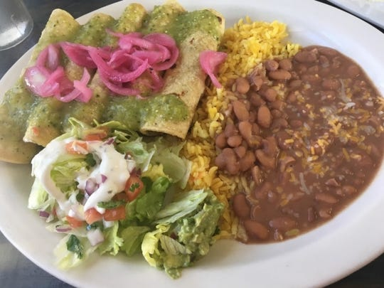 Costa Azul Mexican Restaurant's cochinita tacos are Yucatan-style corn tortillas filled with flavorful slow-roasted Mayan pork smothered in a mild habanero sauce and crisp, tart pickled onions. They came with a large side of pinto beans, Spanish rice and a small salad of lettuce, tomato, sour cream and guacamole.