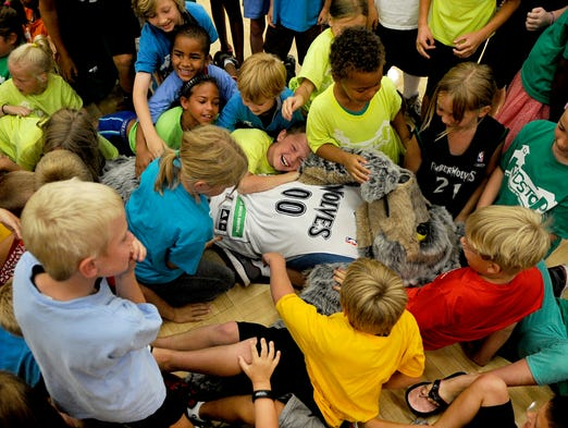 Crunch the Minnesota Timberwolves mascot, gets trampled by kids who attended the caravan. The Wolves Caravan stopped at Apollo High School on August 7th in St. Cloud. The event featured players Corey Brewer and Ronny Turiaf