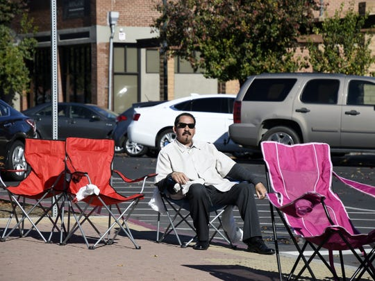 German Navarrette camps out on the corner of Main and Garden Streets in downtown Visalia to make save a spot for the 72nd Candy Cane Lane Parade.