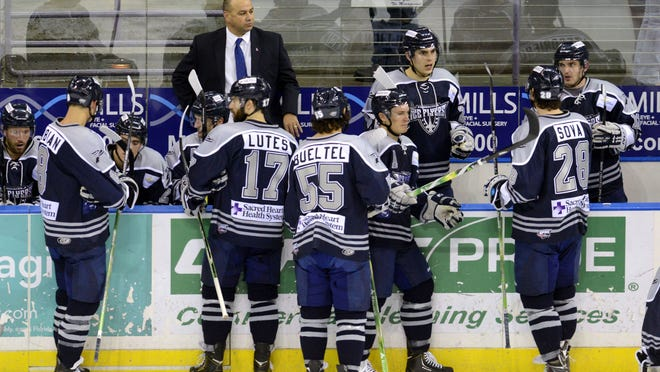 Ice Flyers coach Rod Aldoff and his players.