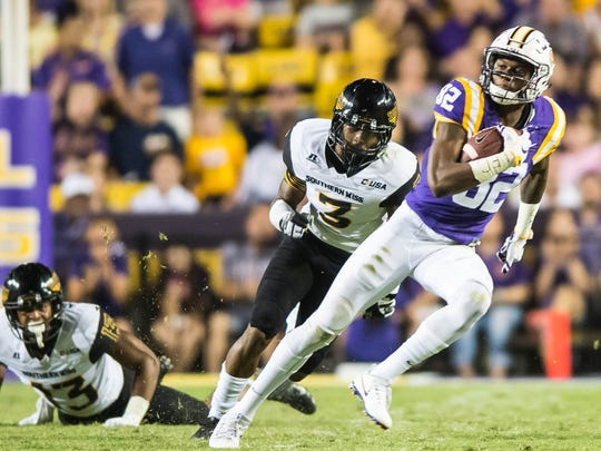 LSU Tigers wide receiver D.J. Chark (82) with the reception races to the outside to score again for the Tigers in Baton Rouge on Saturday October 15, 2016 BUDDY DELAHOUSSAYE/ THE ADVERTISER