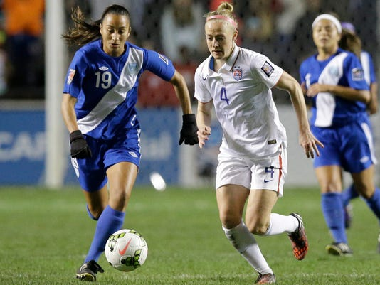 United States' Becky Sauerbrunn (4) and Guatemala's Diana Barrera (19) chase the ball during the second half of a CONCACAF Women's Championship soccer game Friday, Oct. 17, 2014, in Bridgeview, Ill. The United States won 5-0. (AP Photo/Nam Y. Huh)
