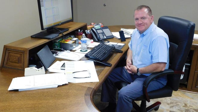 George Secor, president and CEO of Sunrise Cooperative Inc., sits at his office desk at the Fremont headquarters.