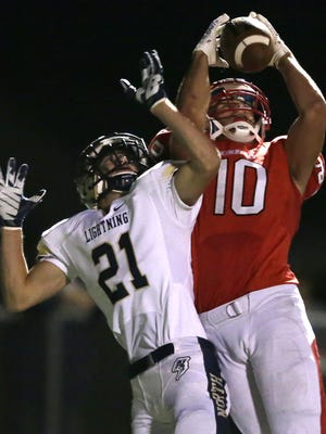 Kimberly High School's Jordan Janssen (10) goes up for the ball against Appleton North High School's Jack Fischer during their football game on Sept. 18 in Kimberly. Wm.Glasheen/Post-Crescent Media