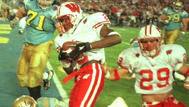 Jamar Fletcher returns an interception for a touchdown in the fourth quarter in the University of Wisconsin's 38-31 win in the 1999 Rose Bowl over the UCLA Bruins.