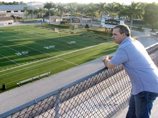 Shawn Berner, a Bishop Verot graduate, looks out over the field he played football on in high school. Berner was the head football coach at Fort Campbell High School in Kentucky for 11 years and is having a Hollywood movie made about his experiences.