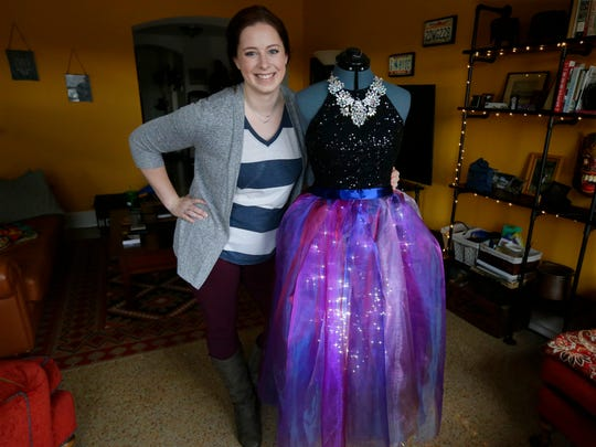Teresa Hammer has designed an elaborate dress, complete with decorative lighting, for her costume she'll wear when she attends the sold-out Yule Ball-theme party at Turner Hall on Saturday night. She also baked and decorated some 120 Harry Potter-themed cookies that will be sold to raise money at the event. She's pictured in her Shorewood apartment on Thursday, Jan. 11, 2018.