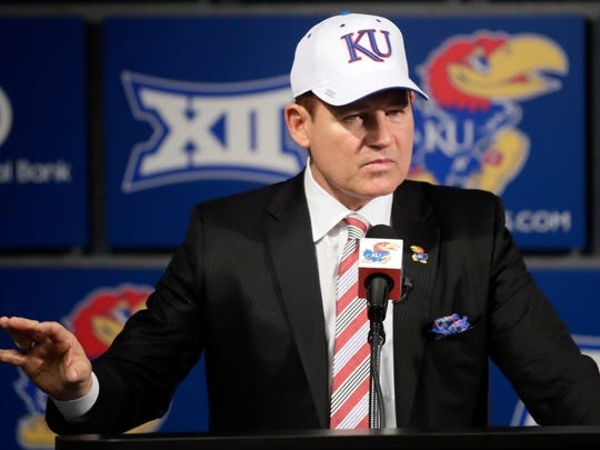 New Kansas football coach Les Miles makes a statement during a news conference in Lawrence, Kansas, on Nov. 18, 2018.