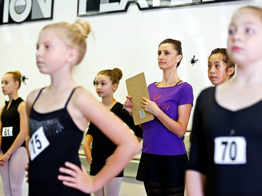 """Moscow Ballet ballerina Alisa Bolotnikova examines young dancers who hope to dance in the Moscow Ballet production of """"The Nutcracker"""" in Springfield later this year. The audition was held at Point Performing Arts in Springfield, Mo. on Oct. 1, 2016."""