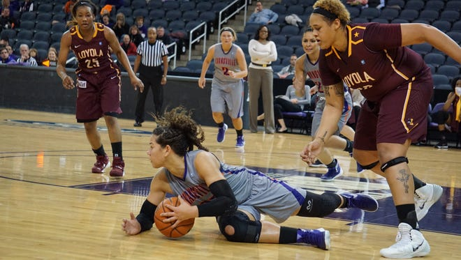 Evansville forward Sasha Robinson, center, dives to the floor for a loose ball during a game against Loyola last season at the Ford Center. It's a routine play for Robinson, a four-year starter who has hustled her way up UE's all-time rebounding list.