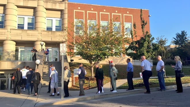 About 75 people were in line before doors opened for early voting Wednesday, Oct. 19, at the Howard Office Building   on 2nd Ave in Nashville
