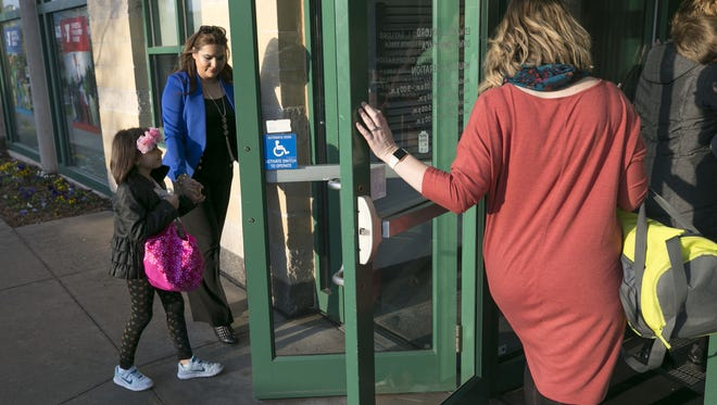 Marina Montoya-Zorrilla of Moore, Oklahoma, drops off her daughter, Heidi Zorrilla, 8, a second grader, at the Edward E. Gaylord Downtown YMCA in Oklahoma City before heading to work, on the second day of the Oklahoma teachers walkout, on Tuesday, April 3, 2018. The YMCA extended their before- and after-school program hours to help working parents because of the teacher walkout.