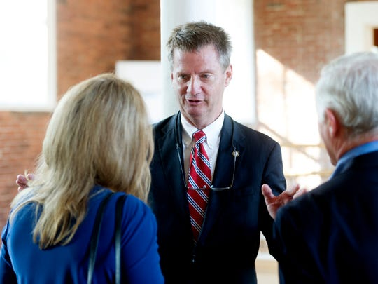 Knox County Mayor and congressional candidate Tim Burchett chats with Laura Hoolingsworth, President of the USA Today Network - Tennessee during the Knoxville News Sentinel's USA Today Network - Tennessee launch celebration and welcome for News Sentinel President Frank Rosamond at The Southern Depot in Knoxville, Tennessee on Tuesday, August 8, 2017.