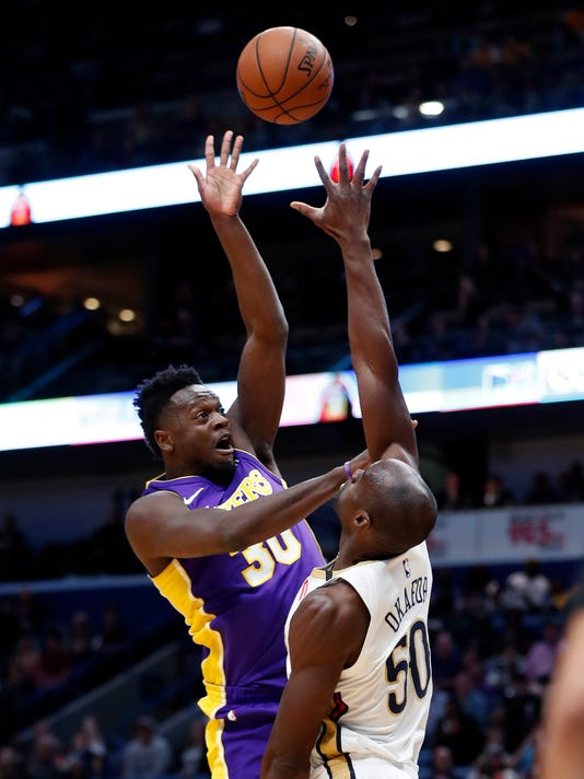 Los Angeles Lakers forward Julius Randle (30) shoots over New Orleans Pelicans center Emeka Okafor (50) in the first half of an NBA basketball game in New Orleans, Thursday, March 22, 2018. (AP Photo/Gerald Herbert)
