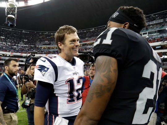 New England Patriots quarterback Tom Brady, left, talks with Oakland Raiders cornerback Sean Smith, right, after an NFL football game Sunday, Nov. 19, 2017, in Mexico City. (AP Photo/Rebecca Blackwell)