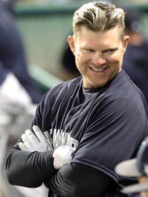 Mar 9, 2018; Lake Buena Vista, FL, USA; New York Yankees designator hitter Adam Lind (41) smiles in the dugout against the Atlanta Braves at Champion Stadium.