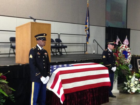 National Guardsmen stand next to the casket of Chief Warrant Officer 4 David Strother prior to Wednesday's visitation.
