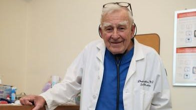 Lloyd Hamilton is pictured at his practice, Health Lifeline, in Nyack on April 2.  The 86-year-old runs the free medical clinic for people with no other access to care.
