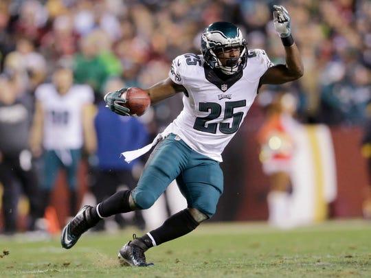 Philadelphia Eagles running back LeSean McCoy carries the ball during an NFL football game against the Washington Redskins.