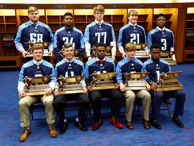 Mr. Football winners sit with their trophy at Nissan