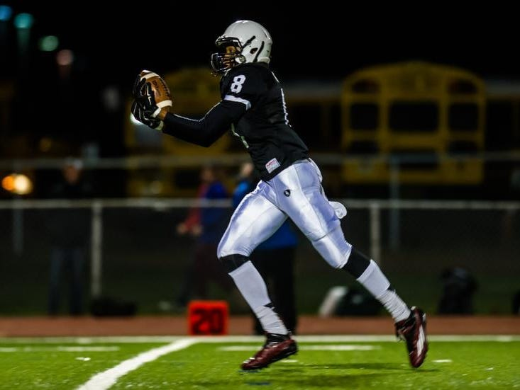 Bridgewater-Raritan's Ricky Tate hauls in a 56-yard pass for a touchdown in the first quarter against Ridge in the North 2 Group V semifinal in Bridgewater on Friday.