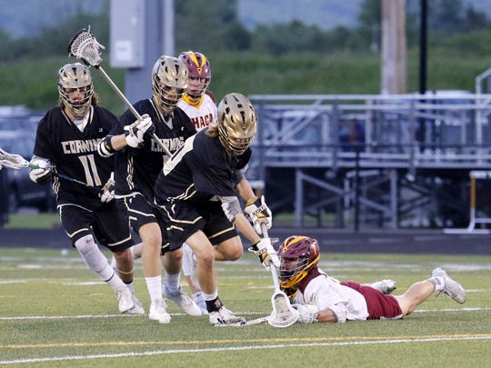 Corning's Casey Nevins, front, and Ithaca's Ryan Sposito go for the ball as Corning's Collin Neally (11) and Ryan Burns follow the play Thursday during the Section 4 Class A championship game at Corning Memorial Stadium.