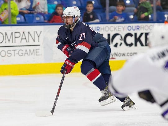 David Farrance of Victor heads up ice for USA Hockey's U18 team. The offensively gifted defenseman is in the Chicago for the 2017 NHL Draft.
