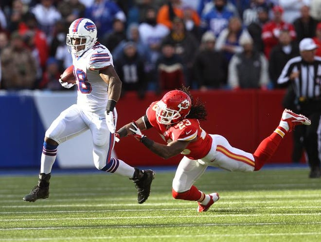 Bills running back C.J. Spiller (28) gets past a diving Kendrick Lewis as he breaks a 61 yard run. Spiller finished with 116 yards rushing.