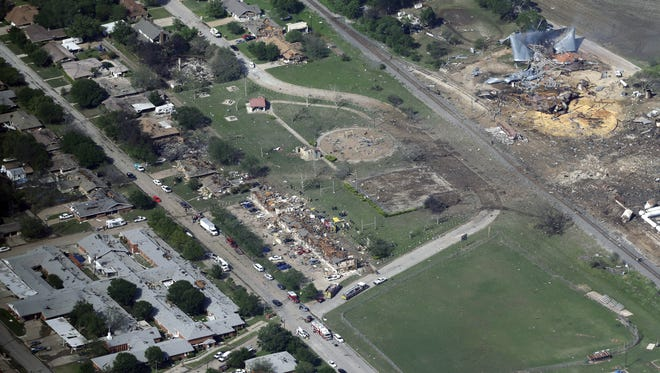 FILE - In this April 18, 2013 aerial file photo are the remains of a nursing home, left, apartment complex, center, and fertilizer plant, right, destroyed by an explosion in West, Texas.